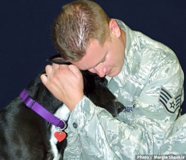 Photo of soldier and dog by Margie Shankle