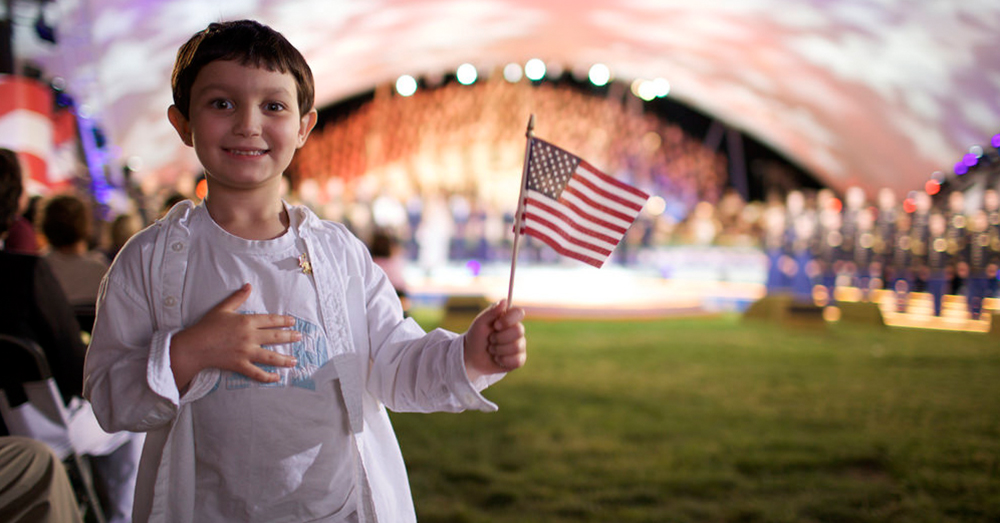 U.S. Army/Robert McIver -- A young patriot salutes heroes at the 2009 National Memorial Day Concert on the West Lawn of the United States Capitol.