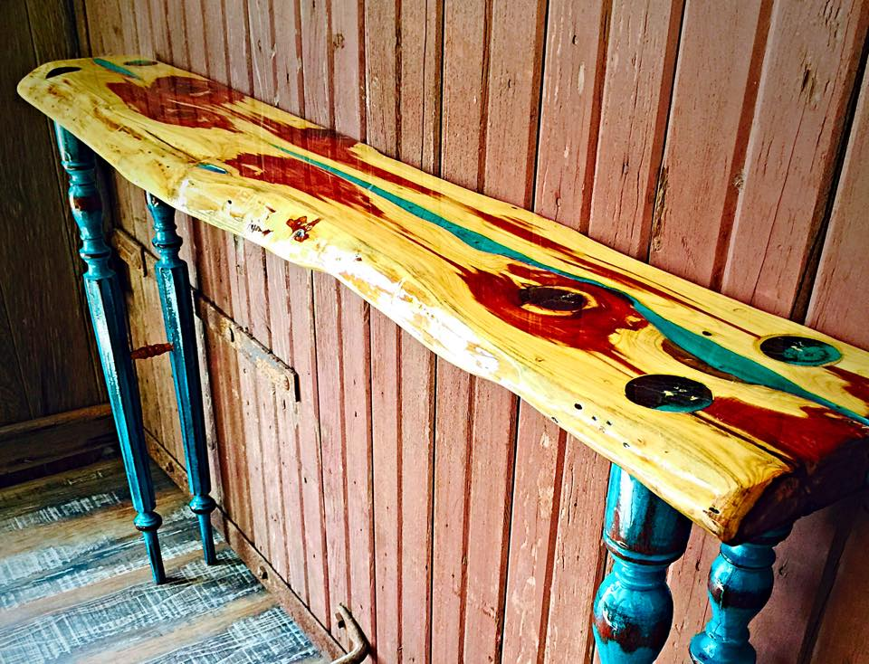 Here is a Live edge cedar slab and old table legs entry way table that I built. I epoxied it for a smooth glass like finish.