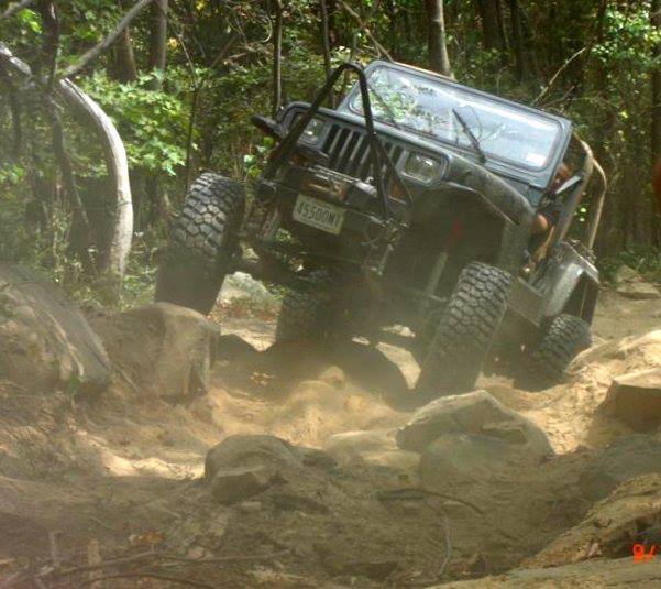 Me wheeling at Big Dogs off road in West Virgina with my 94 YJ.