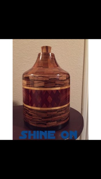Moonshine Jug made out of exotic woods.