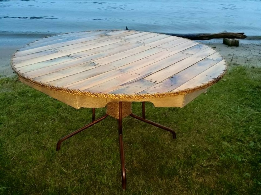 Broken glass top padio table remade with pallets and edged with twine sewn on by 16ga wire.