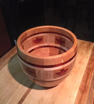 Six Thunderbirds in a segmented bowl made of cherry bloodwood yellow heart and curly maple