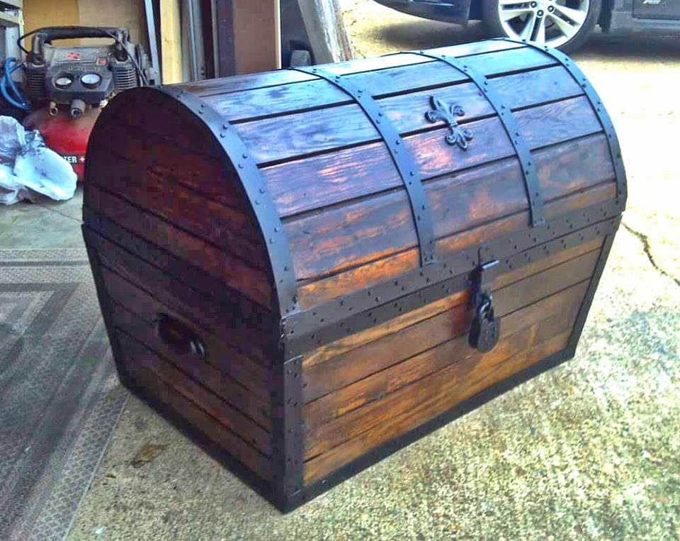 Treasure chest I built from salvaged flooring that was over 100 years old. It took a lot of work to strip the many layers of varnish paint and tar paper that was on top of it. But finally after planing and lots of sandpaper  the beautiful oak came back to life. A few coats of stain and finish with a little creativity I created this for the foot of the bed.