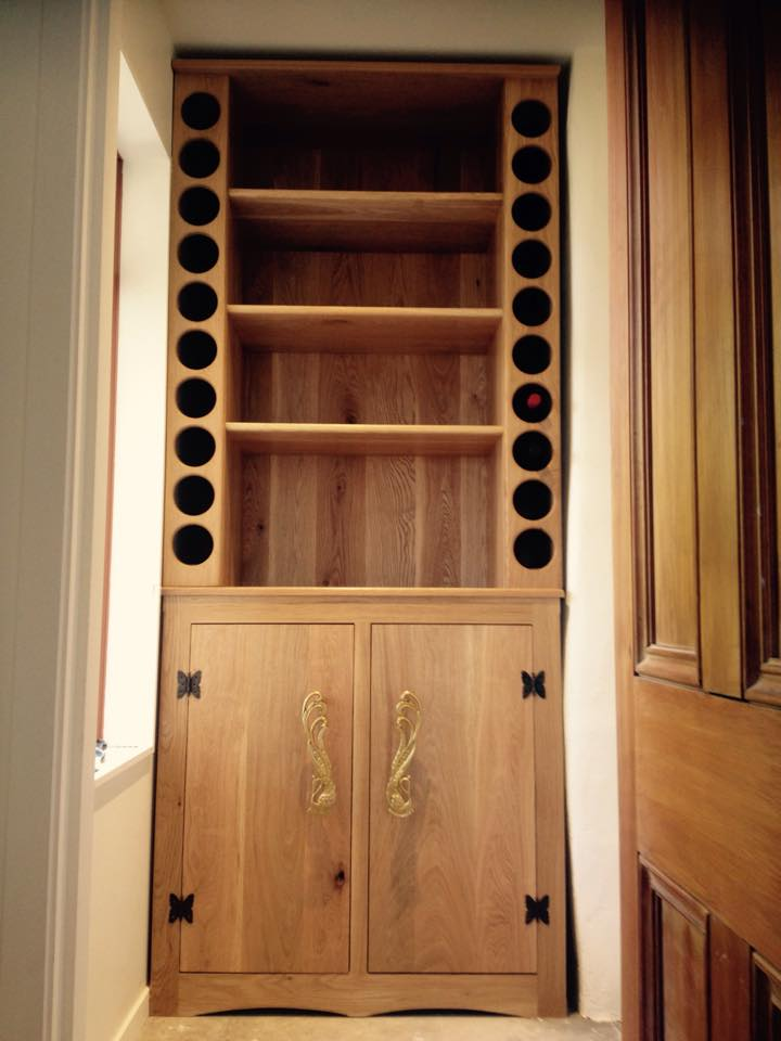 I've been working on something for a couple of months and have been waiting till its done to send a couple pics. It's a feature commissioned hallway piece made from white oak holds 20 bottles of wine and the shelving is for preserves with ample storage in underneath cupboards. This is the biggest and nicest piece I have ever made. It weighs about 140 kgs top half 80 by itself. Over 200 dowels  for joints 200 biscuits for laminating all the boards together.
