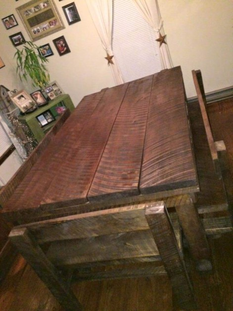 Farm style dinning table with bench seating made from rough cut maple tree was cut from my yard