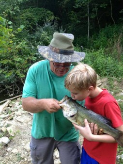 My little cousin and my dad on a day of fishing none of us will ever forget. He caught this giant not ten feet from the shore line and all on a youth rod and reel. Catch a little fish, kiss him and make a wish.