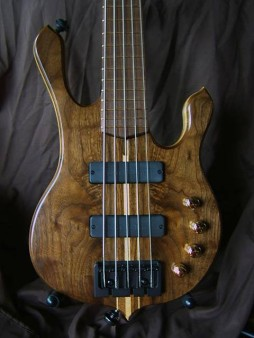 One of the bass guitars I've made. This one has a 7 piece walnut/hard maple neck, soft maple body core, and walnut top and back. The pickups are from Bartolilni, the 3 band eq is from Seymour Duncan, it has a two-way truss rod, and carbon fiber reinforcement bars in the neck.