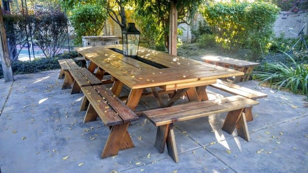 Here is a picnic table I did for someone.  It's nearly 7 feet wide and 20 feet long.  It's got an 8 trough in the middle for drinks or flowers. Fits 28 people comfortably.