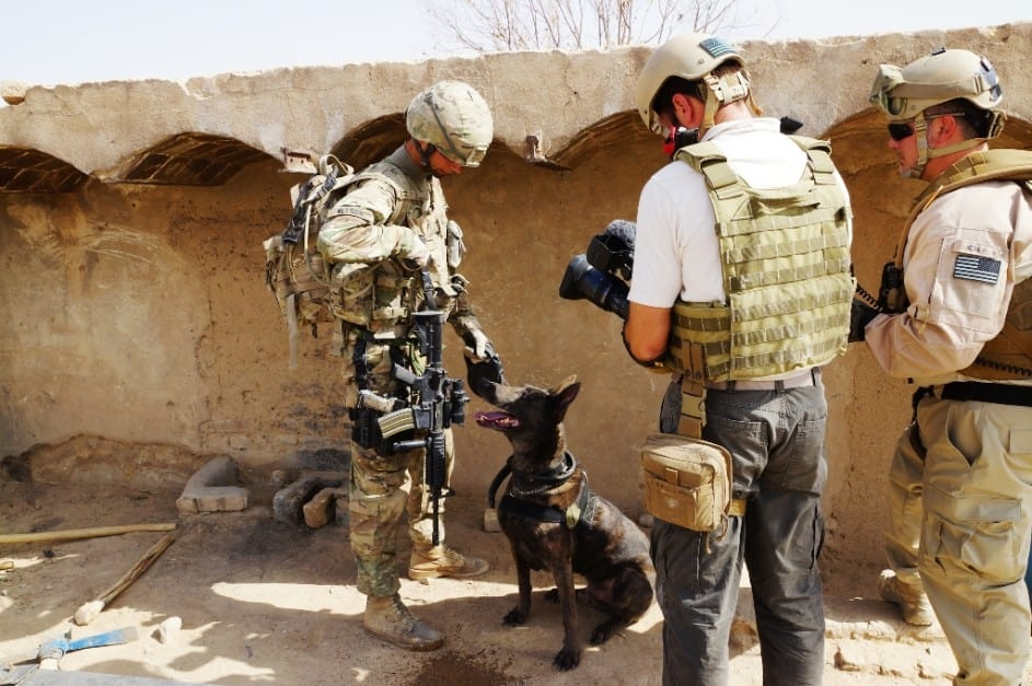 Sgt. Charles Nelson talks to his MWD partner Zzack during their mission in southern Afghanistan in 2012 / Via U.S. Army and Staff Sgt. Paul Evans