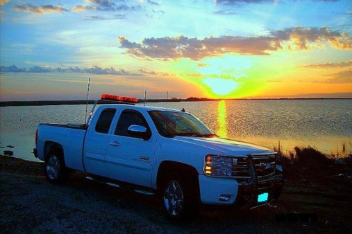 From Glen 'Bo' Gillum: My 2009 Texas Edition Silverado at the ol' fishin' hole.