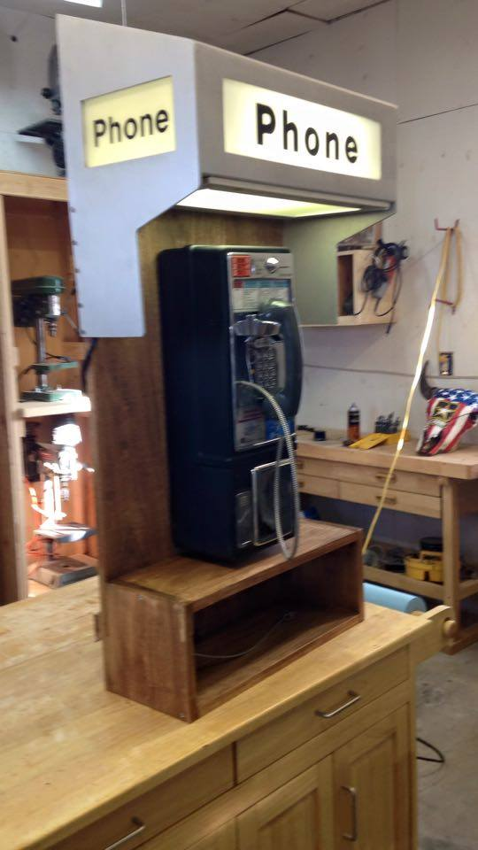 From Leon Drew: Restored a old pay phone and built a little stand and enclosure . I've been in Telecommunications for 35 years collect old phone stuff.