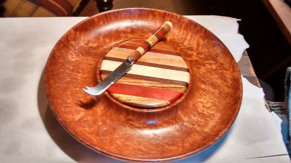 From Marvin Jones‎: This is a redwood burl cheese and cracker bowl w/exotic wood cutting board center and matching cheese knife