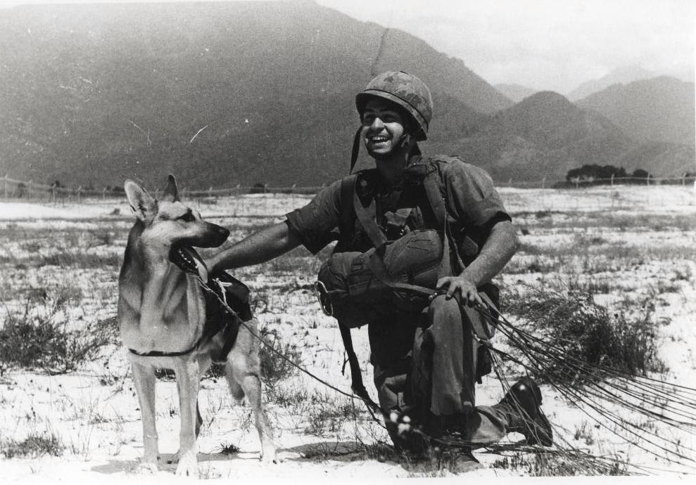 """Sgt. Spano and his War Dog Lobo completing a parachute jump in Da Nang, Vietnam, August 1968."" / Via USMC Archives"