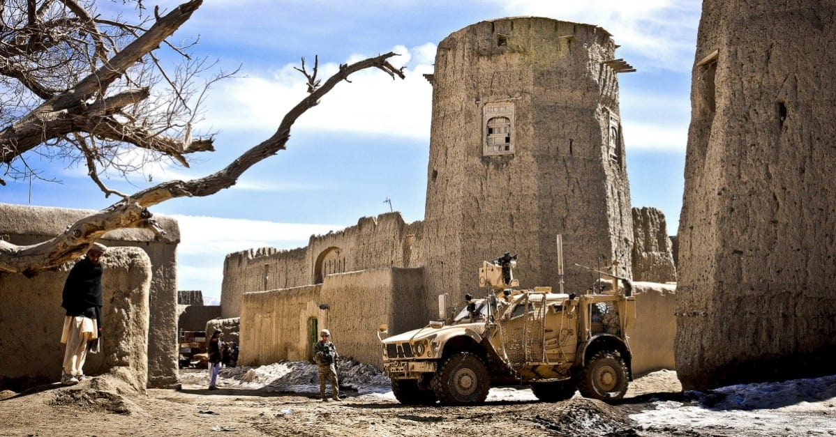 U.S. Army Soldiers cordon off the town square of a small village near Combat Outpost Yosef Khel in 2012. / U.S. Army and Sgt. Ken Scar, 7th MPAD