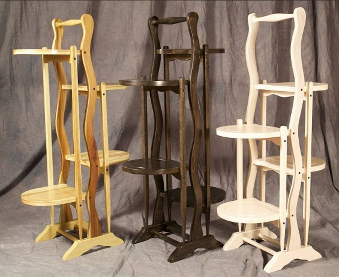 From Ken Forsberg: My interpretations of an antiquated violet stand. Christmas presents inspired from an original creation of bygone furniture builders: California Furniture Shops LTD.  Articulating shelves fold up. Conversion varnish on poplar; green poplar selected for color.