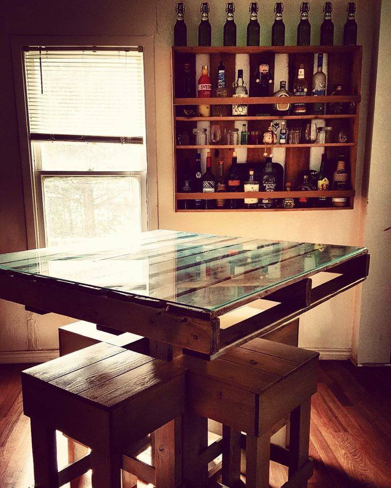 From Krista Huber: Pallet table and liquor shelves/wall bar made by Adam Medina-Trojacek for our first home
