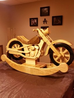 From Bradley Madonna-Anderson‎: Rocking motorcycle for child or grandchild. Unique family heirloom that can be passed down for generations. Wheels & forks actually turn!