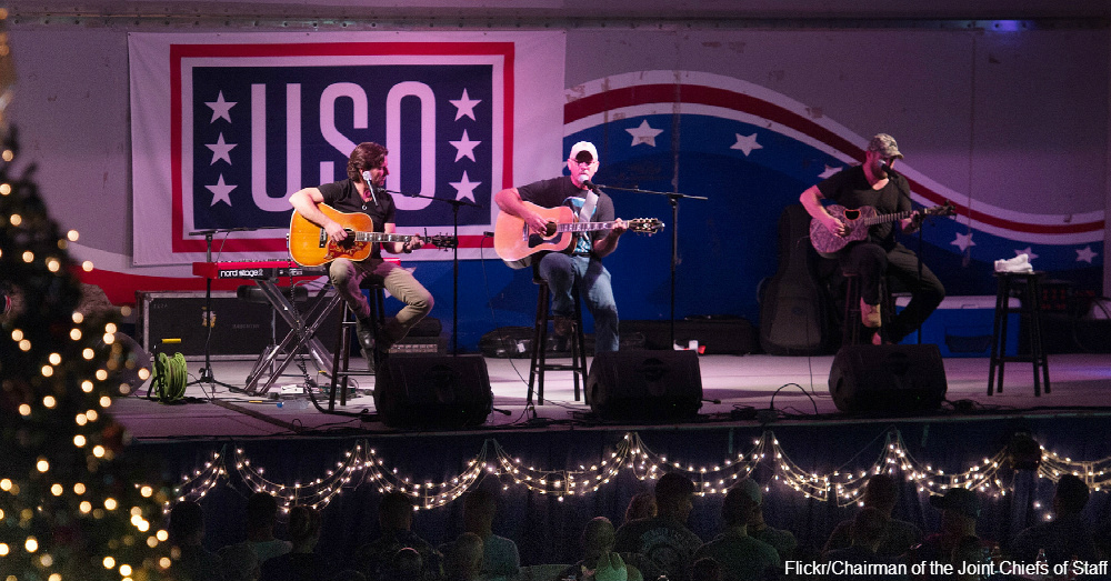 "Brett James, Kyle Jacobs, and Billy Montana perform during a USO show at Camp Lemonnier, Djibouti"" / Via Chairman of the Joint Chiefs of Staff"