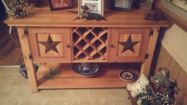 From James Hill: Milled down rough cut 4×6 California White Cedar to make this buffet. Built from looking at a picture on google, but added the stars because my wife loves country stars.