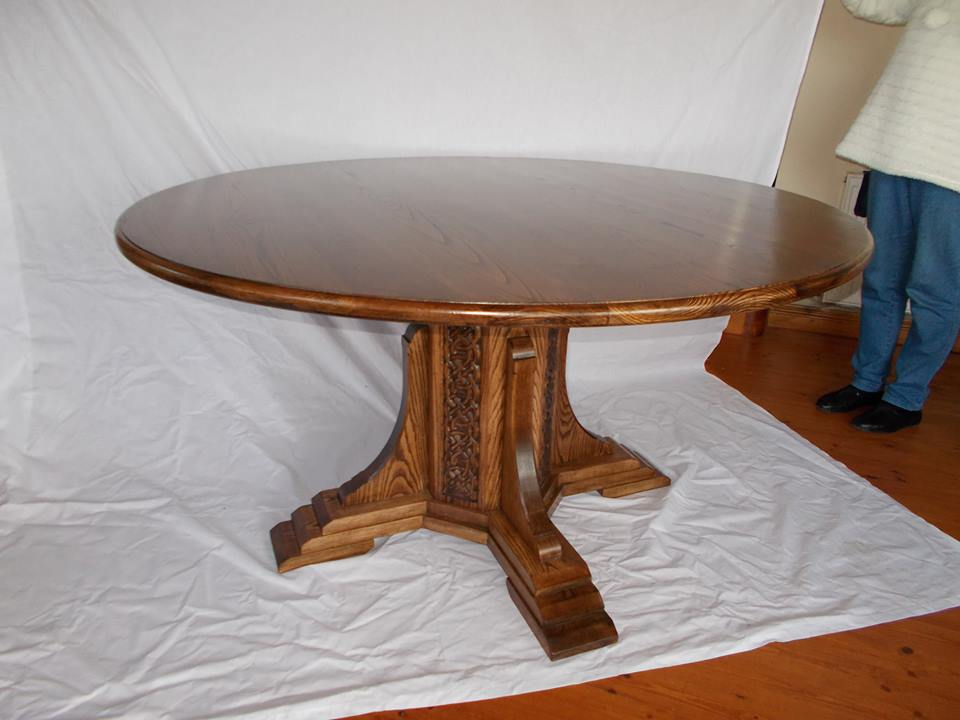 From Paul Griffiths: Here is a table with Celtic Knot carving on the octagonal base.It's made from stained ash.From Waterford Ireland
