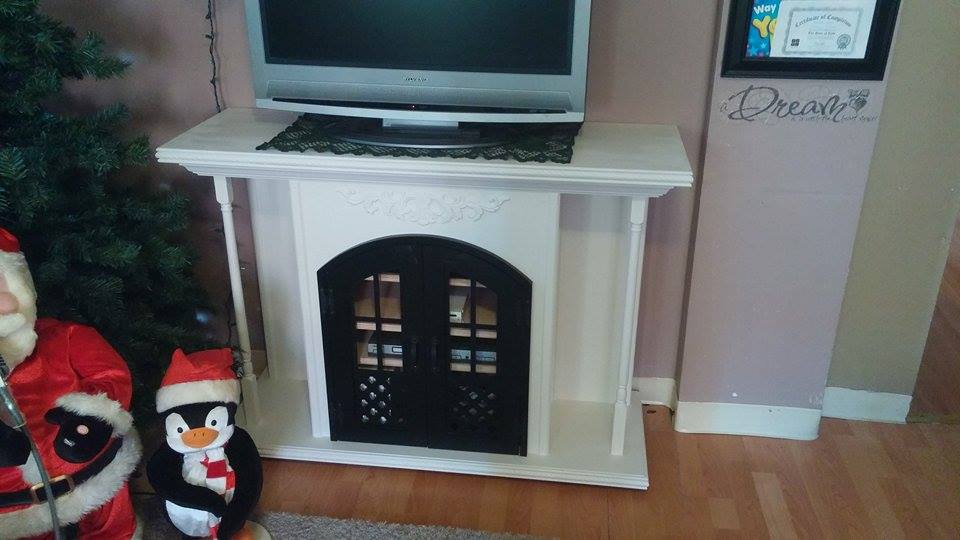 From Thomas Welch: I call it my Firetainment Place it looks like a firebox/mantle piece but its actually an entertainment center. 3/4 Birch Ply, Pine mouldings and poplar spindles.