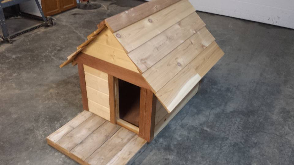 From Vince Os‎: Dog house built built from cedar and pine.