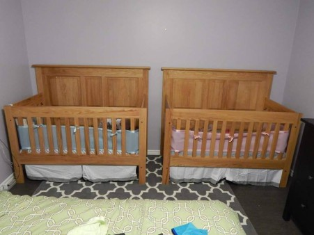 From Andrew Kenny: Matching red oak convertible cribs I made for my twins. Finished with linseed oil and beeswax.