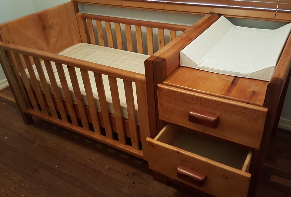 From Cameron Summerville: a picture of the baby cot I made. It is mostly silky oak with she oak legs and red cedar draw handles. Shellac finish.