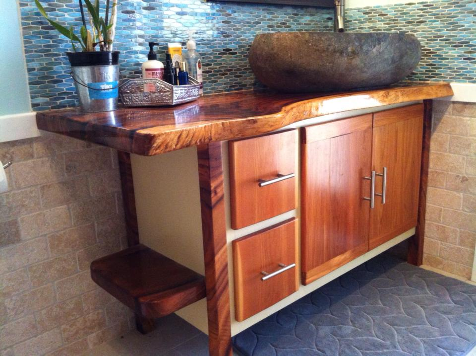 From Chad Fleming: Monkey pod top & legs, dried ten years on Kauai. cedar body and doors/ drawers. Sink is stone from Bali.