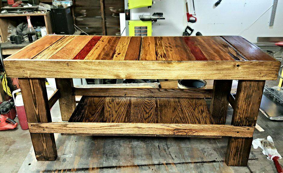 From Terry Placer Jr: This is a coffee table i made from recycled pallet wood . Jacobean stain , 1 coat of hardwood floor sealer followed by 1 coat of a Satin hardwood floor poly . Was very surprised to find such awesome lumber in these pallets . The planer brought it all to life .