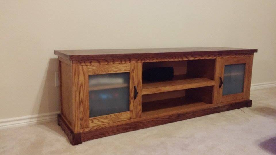 From Bill Barstow: Just finished up this 6' TV stand. It's made from live oak and red oak for the man cabinet.