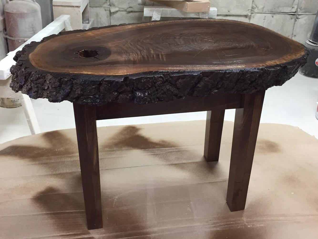 From Julie Kinsley: This is a solid walnut table I designed and built. Over the course of several days I sanded and smoothed and prepped the top surface , and then fabricated the legs of the table after that.