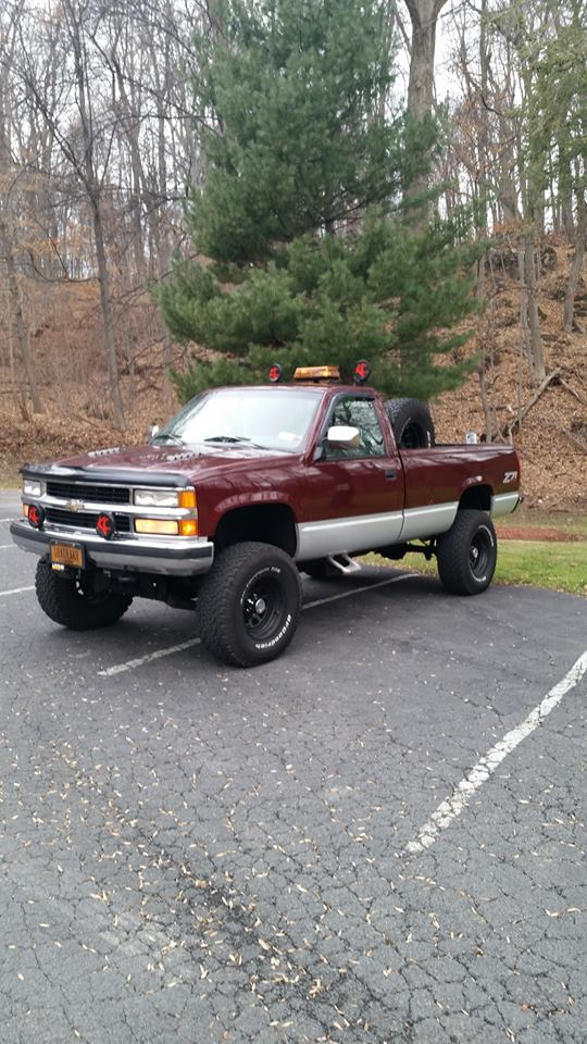 From Mark Thompson: My '94 Z71 with 50K original miles, 6 inch Rough Country suspension lift, leveled, Turbo400, locker w/4.56's, Flowmaster duals, BFGoodrich 35's...