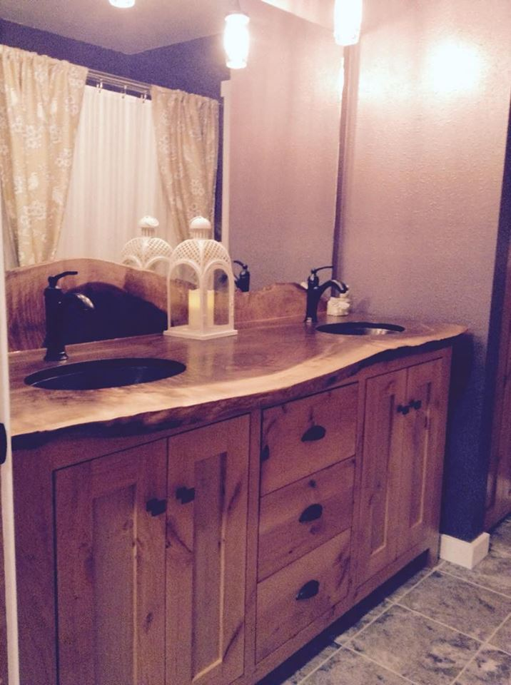 From Wade Sims: New bathroom vanity. Walnut slab top and knotty alder base cabinet.