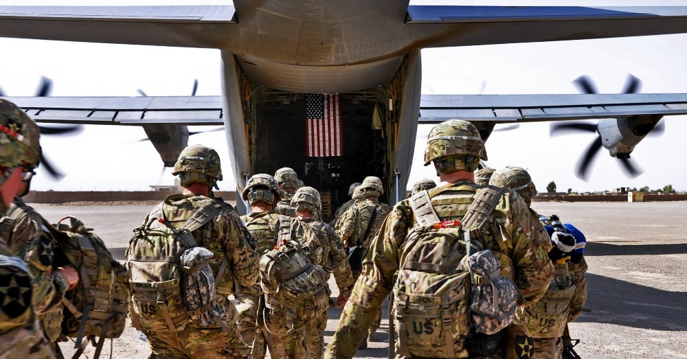 Soldiers leave Afghanistan to head for Joint Base Lewis-McChord / Via the U.S. Navy and Lt. Chad A. Dulac