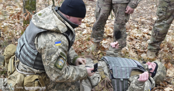 Soldiers with the Ukrainian Land Forces practice on how to apply a tourniquet.