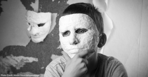 Boy with carnival mask