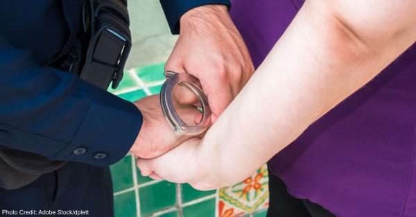Under Arrest Police Officer Handcuffing Criminal Suspect