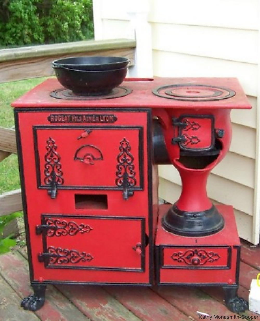 Red and Black Iron Wood Burning Stove