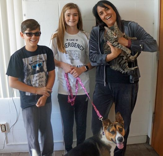 Ami and Mikaela with their new furever family. (Credit: Helen Woodward Animal Center)