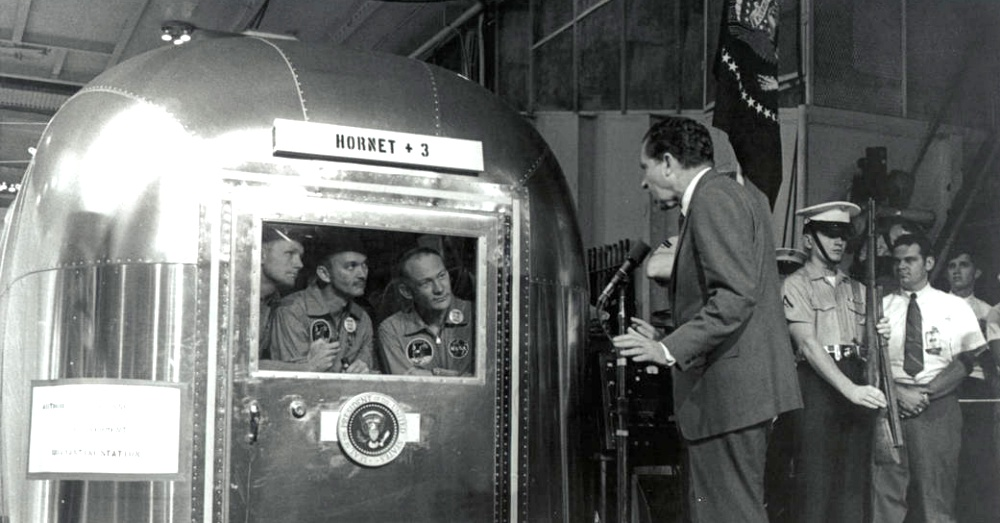 President Nixon talks to the crew of Apollo 11 from outside of their Airstream / Via NASA
