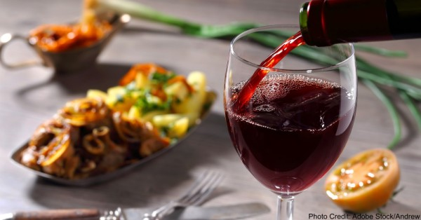 Pouring red wine and food