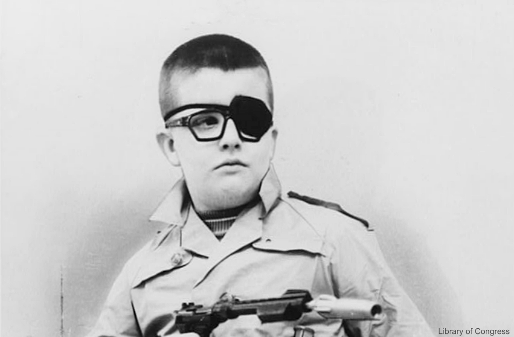 Boy with an Eye Patch and Toy Gun