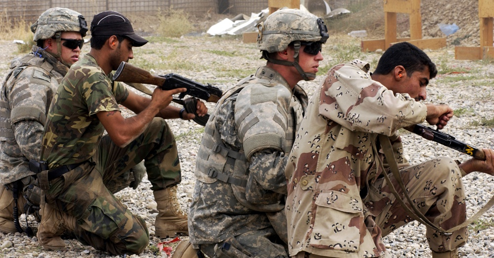 U.S. Army soldiers and Iraqi police officers during an AK-47 training exercise / Via U.S. Army and Airman 1st Class Christopher Hubenthal, U.S. Air Force