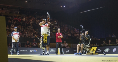 U.S. Marine Corps Maj. Richard Burkett releases an arrow during the gold medal match against Canada's Cpl. Luc Martin. Burkett won the gold medal in the mixed individual compound bow category of the Archery event at the inaugural Invictus Games in London.