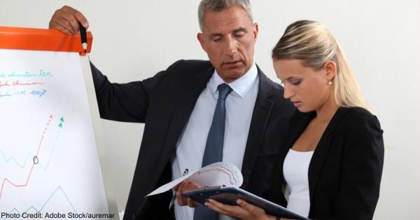 Business professionals comparing data