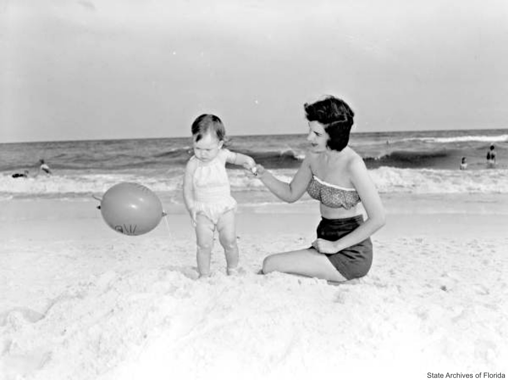 Mother and Baby on the Beach with Balloon