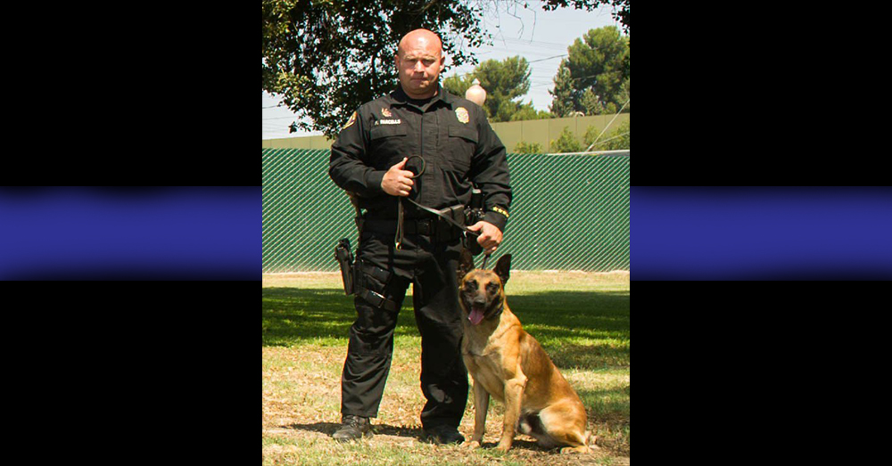 Photo: Long Beach Police Department -- K9 Officer Credo with his handler, Officer Mike Parcells.