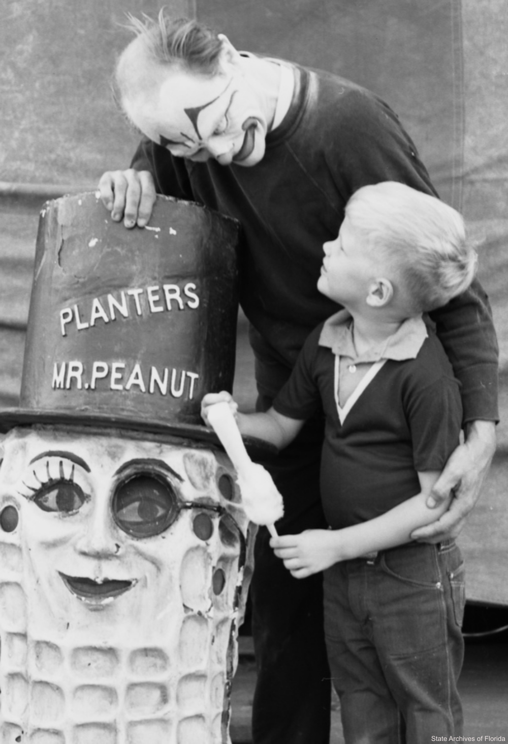 Clown with Boy at Circus Near Mr. Peanut Statue